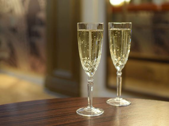 Free glass of champagne offer - The Palm Court